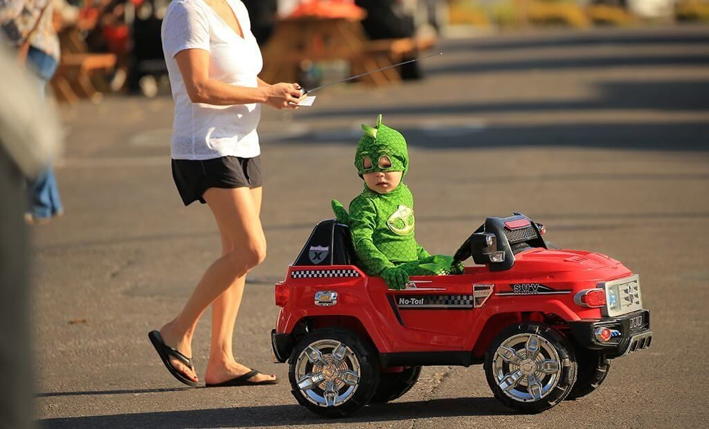 kid-in-costume-riding-power-wheels-1024x620