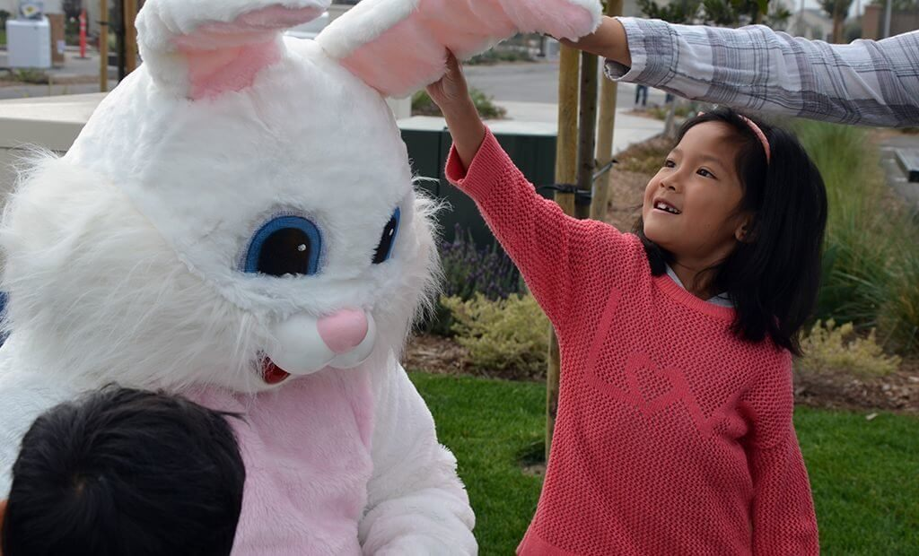 kid-touching-easter-bunnys-ears-1024x620
